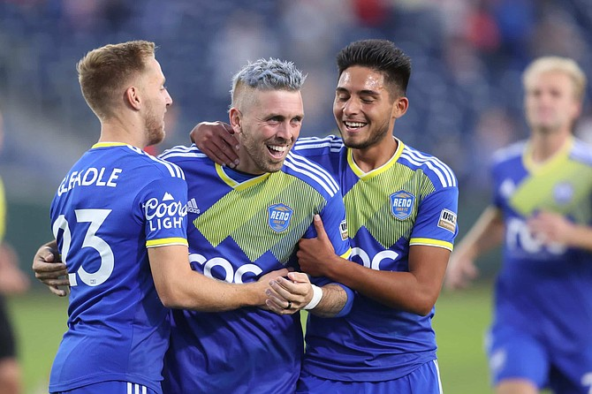 Reno 1868's Corey Hertzog celebrates with teammates after scoring the opening goal of the Western Conference Semifinals against Phoenix Rising.