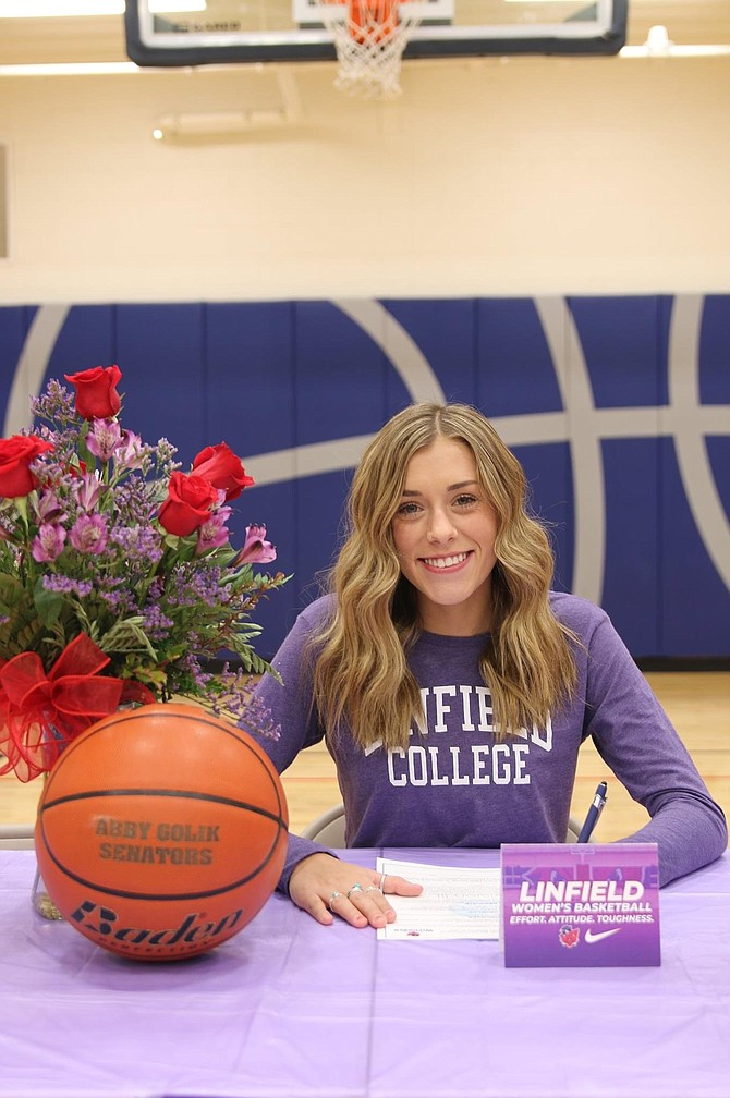 Carson High senior Abby Golik smiles Saturday evening after signing her National Letter of Intent to play women's hoops at Linfield University next winter.