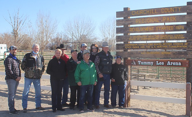 Family and friends gather at the new sign that renames the Green Arena as the Tammy Lee Arena.