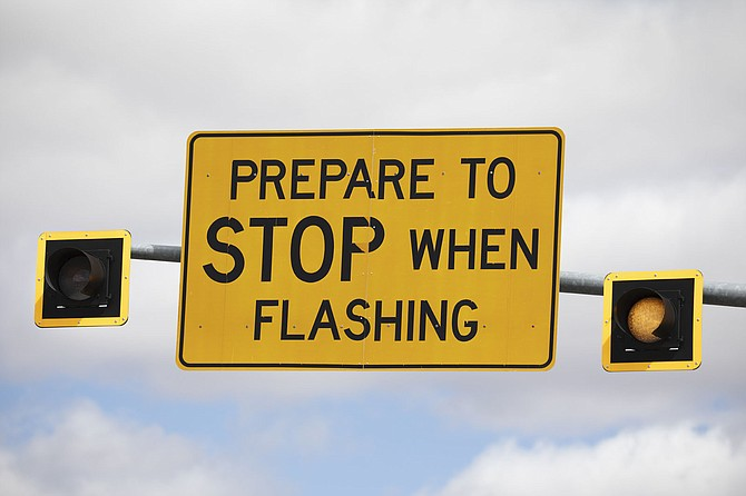 The state is replacing or removing warning signs that might actually encourage people to speed up to make a light.