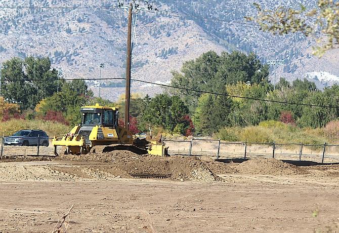 A tractor works on the Gardnerville Maverik site in October.