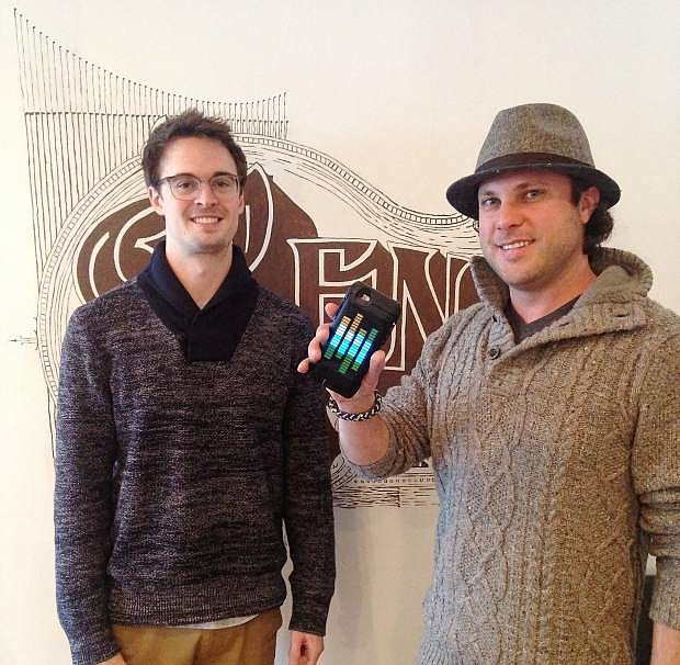 Candel CFO Ross Diedrich, left, and the company's CEO and Founder Matt Sikora display the technology of Candel.