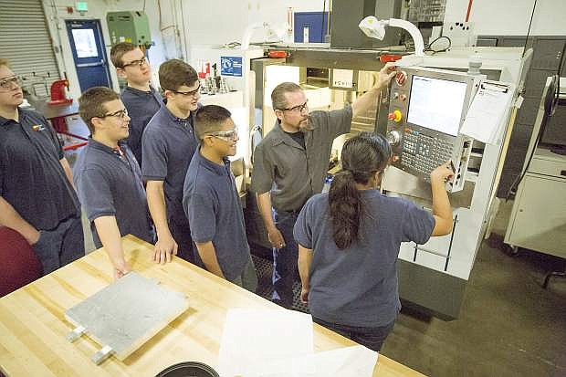 Students at TMCC learn how to operate computer controlled machinery.