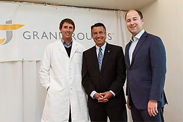Rusty Hoffman, MD (left) and Owen Tripp, co-founders of Grand Rounds, were welcomed to northern Nevada by  Gov. Brian Sandoval.