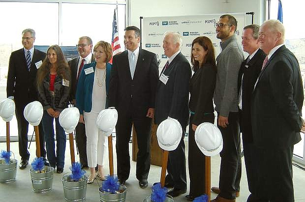 Gov. Brian Sandoval, fifth from left, and Michael Dermody sixth from left, are accompanied Wednesday by representatives of government and business partners at the symbolic ground breaking for Dermody Property's LogistiCenter at 395 Phase 2.