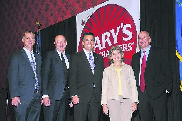 Nevada Gov. Brian Sandoval (third from left) pose with executives from Mary's Gone Crackers at a press conference on May 23. From left to right are: Dong Long, plant manager; Gary Zink, vice president of manufacturing; Sandoval; Mary Waldner, founder; and Craig Fraser, vice president of human resources.