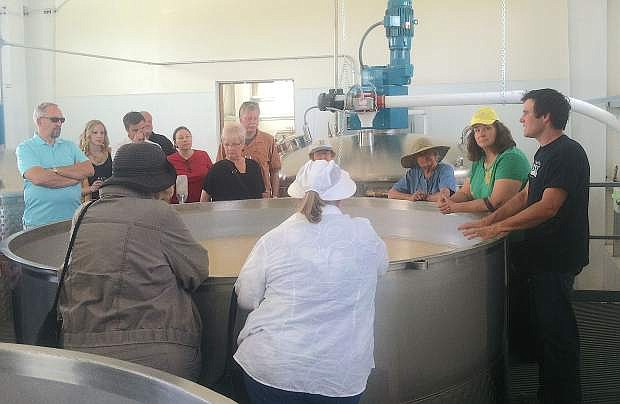 Frey Ranch is hosting a two-year anniversary party on Oct. 15. Colby Frey shows a group in 2014 the process for making liquor.