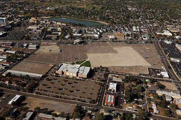 Reno Land Inc.'s purchase of the long empty Park Lane Mall site closed escrow last month. The site can be seen in this aerial photo looking west with the intersection of Plumb Lane and South Virginia Street seen in the upper right of the photo.