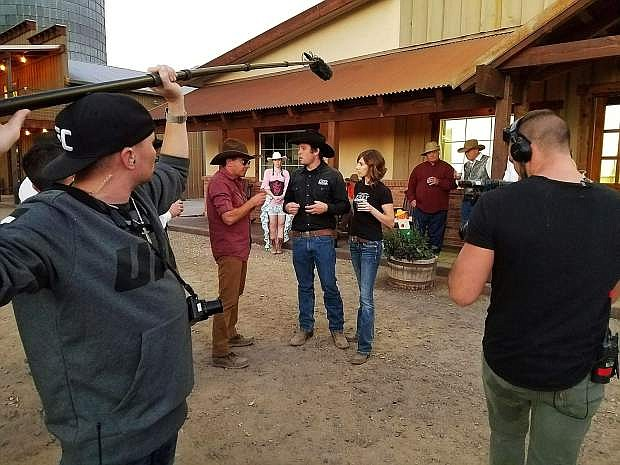 The host of Booze Traveler, Jack Maxwell, in the red shirt, talks on camera to the owners of Frey Ranch, Colby, center, and Ashley Frey, for a segment of the Travel Channel program that will broadcast Monday, April 3.