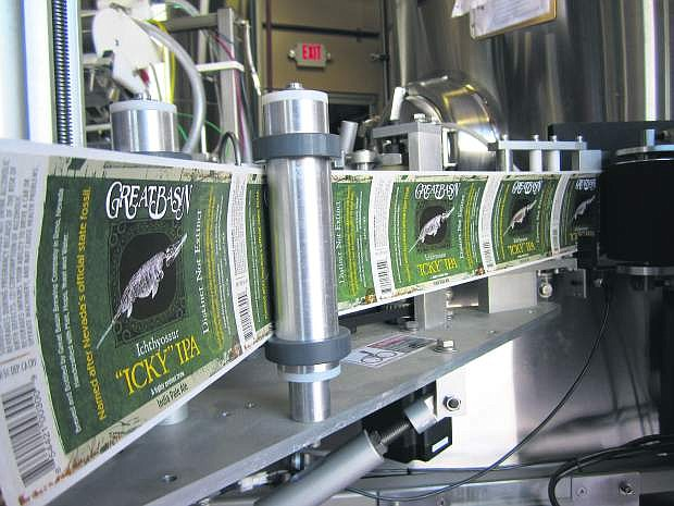 """Labels for Great Basin Brewing Co.'s Ichthyosaur """"Icky"""" IPA roll off the press. The beer was recognized at the at the 2017 Los Angeles International Beer Competition."""