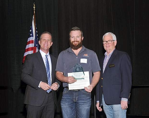 Lt. Gov. Mark Hutchison (left), Brian Graham, Q&D Construction, Inc. and Nathan Roach, Gradex Construction, at the 18th annual PINNACLE Awards.