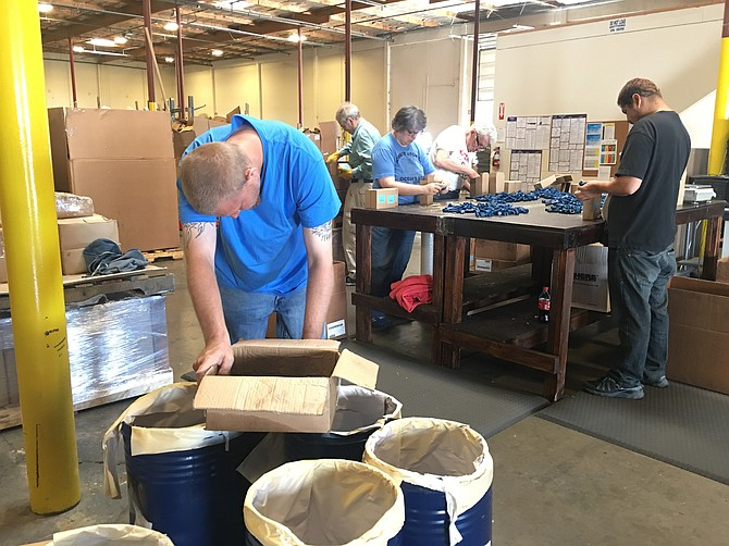 Workers process products at Hodell-Natco, a wholesale distributer of industrial fastener and chain items. The Sparks-based company works with United Cerebral Palsy of Nevada to hire employees with disabilities.