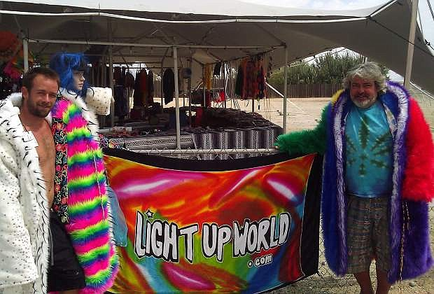 'BooBob' and 'Party Marty' pose in front of the temporary Burning Man shop, LightUpWorld.com, situated on a vacant lot in Gerlach.