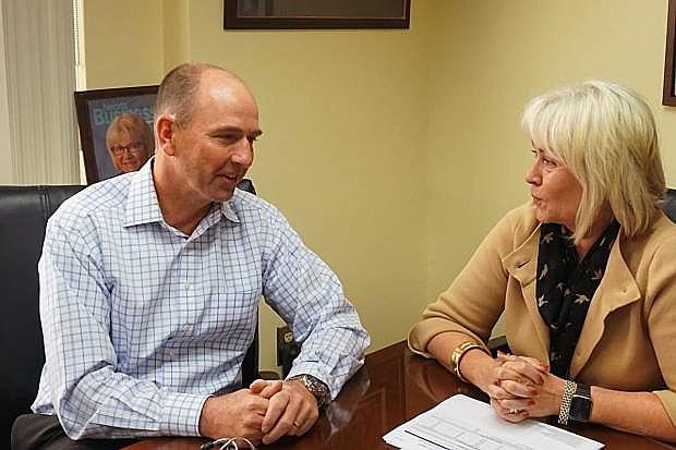 Helen Lidholm and Dri Richard Bryan of Saint Mary's discuss a hospital matter.
