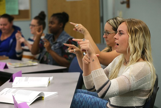 Rachael Seabert, right, and other students work in an American Sign Language class at Western Nevada College in Carson City, Nev., on Tuesday, Sept. 19, 2017.  Photo by Cathleen Allison/Nevada Photo Source