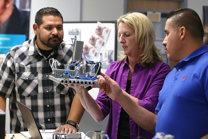 Applied Industrial Technology professor Emily Howarth, center, talks with Ricardo Fregoso and Ezequiel Varela in a class at  Western Nevada College in Carson City.