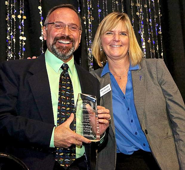 Mark Cameron, vice president of Operations and Public Safety for Reno-Tahoe International Airport, accepts the award for Leaders to Know (High Profile) on behalf of winner Marily Mora, president/CEO of Reno-Tahoe Airport Authority. Stacy Asteriadis of City National Bank presented the award.