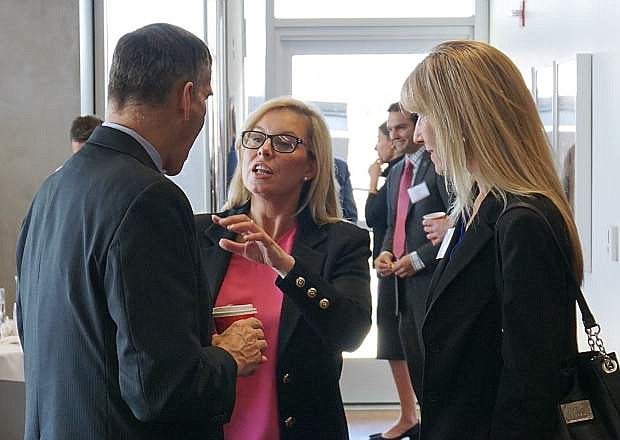 """Reno Mayor Hillary Schieve, center, speaks with EDAWN CEO Mike Kazmierski, left, and Reno-Sparks Chamber of Commerce CEO Ann Silver, right, prior to the """"Blockchain: Building the New Nevada on Trust"""" conference at the Nevada Museum of Art on Tuesday, Feb. 6."""