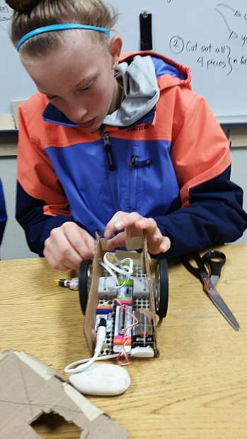 South Tahoe Middle School seventh grader Giulia Lancelloti works on a robot during Maker Lab.