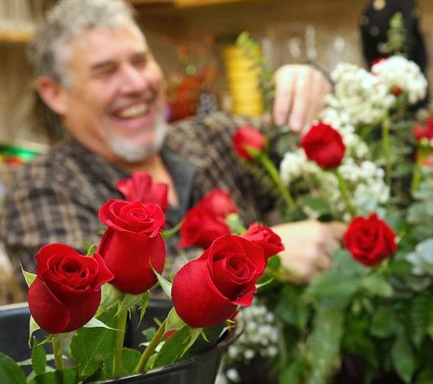 Tom Jones owner of Carson City Florist creates a Valentine's Day bouquet.