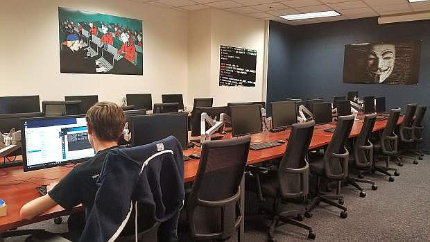 The UNR Cybersecurity Center developed a sandbox lab on campus called the Full Spectrum Cybersecurity Zone, where students can participate in hands-on research testing and training.