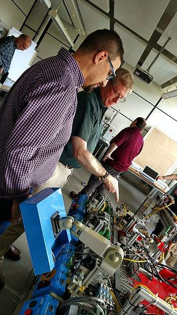 WNC Professor Emily Howarth trained with Siemens Mechatronic Systems Level 1 instructors from around the world to earn her Level 2 instructor credential.