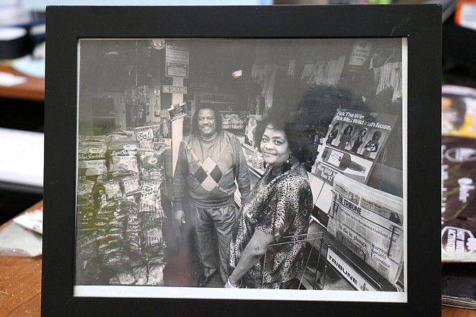 Inside Unbeweaveable owner Rose Buchanan's office is a photo of her parents, Wartney and Luvenia Buchanan, who owned a corner market in Oakland for nearly 35 years.