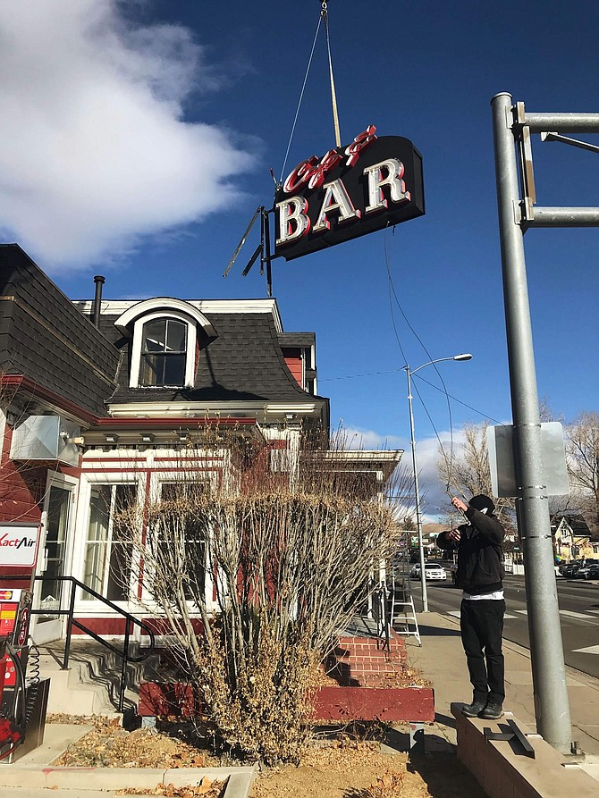 "The ""bar"" sign is removed from Cafe at Adeles before being transported to J's Old Town BIstro in Dayton."