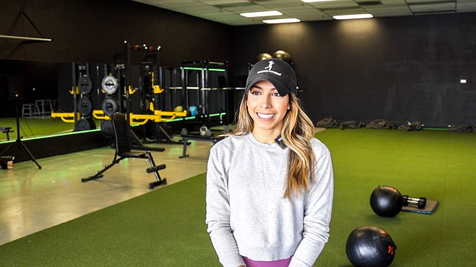Alejandra Salas, owner of Reno Aspire Fitness, is interviewed inside her gym on March 19, 2020.