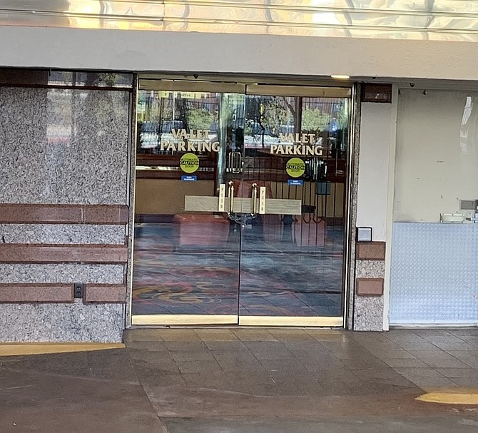 An entry into the Eldorado Resort Casino in downtown Reno is chained and boarded up on March 21, 2020.