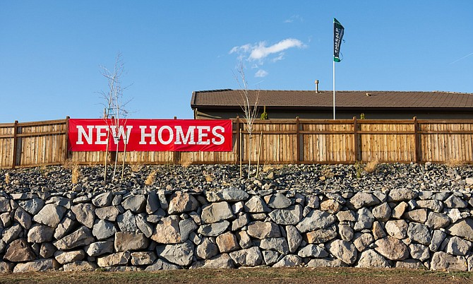 Signs advertising new houses in Verdi, Nev. on Friday, March 6, 2020.