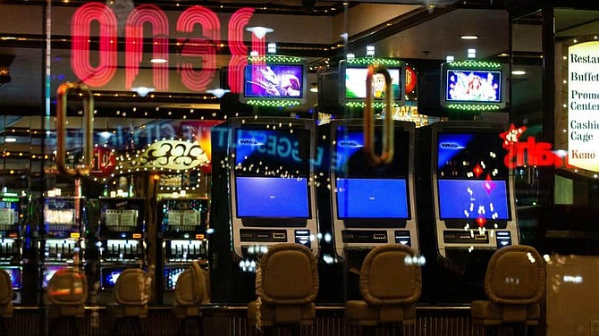 Gaming machines inside the Eldorado Resort Casino in downtown Reno just before midnight on on Tuesday night, March 17, 2020.