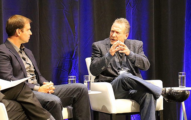 Blockchains, LLC CEO Jeffrey Berns, right, talks about the company's mission during a panel discussion in October 2018, while Tesla Chief Technology Officer JB Straubel looks on.